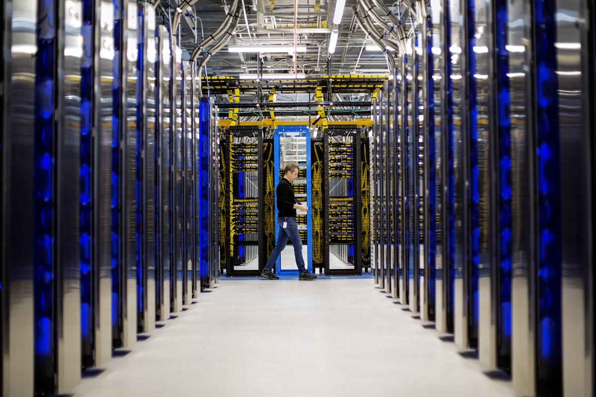 man standing at the end of a datacenter