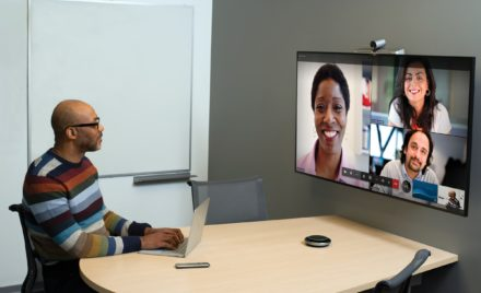 One male in small conference room being used for remote video meeting with Teams Meetings.