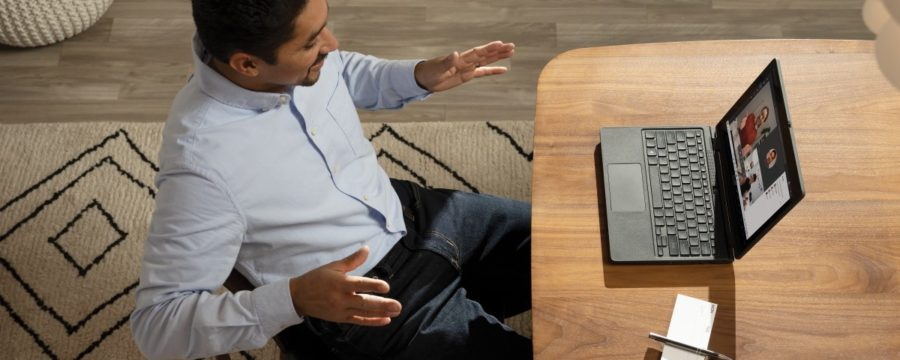 Male teacher with online class with Acer TravelMate B311 2-in-1.