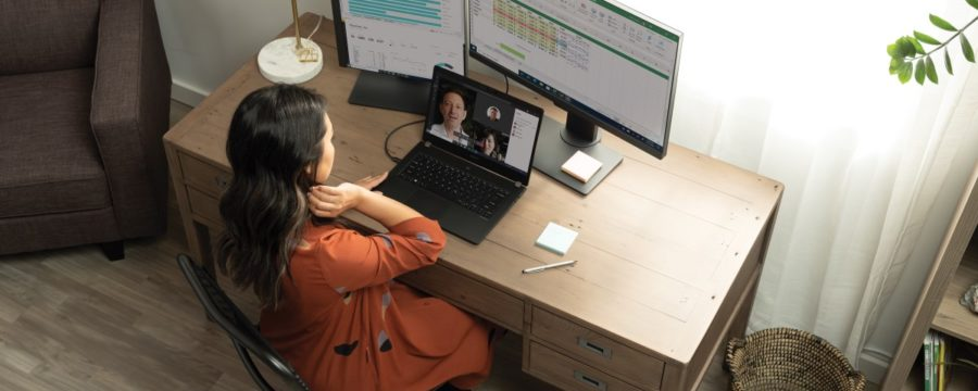 A woman having a Microsoft Teams in her living room home office on her Acer TravelMate P6.