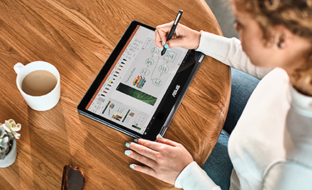 Image for: Image of a woman using a pen on a tablet.