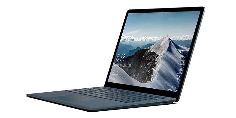 Surface Laptop i koboltblått åt vänster