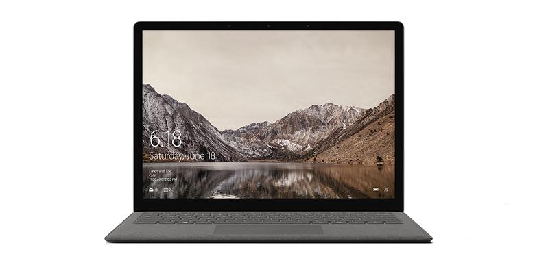 Vy framifrån av Surface Laptop i grafitguld