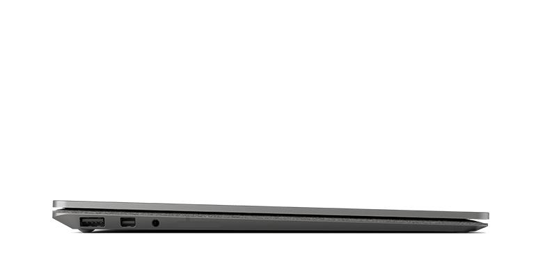 Vy från sidan av Surface Laptop i grafitguld