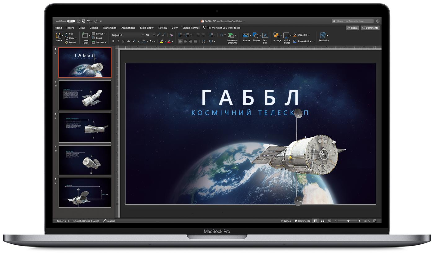 Зображення PowerPoint у темному режимі на екрані MacBook.