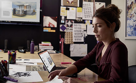 Image for: Image of a woman at her desk.