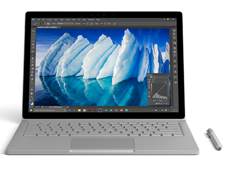 带触控笔的 Surface Book,屏幕上正显示冰山的高分辨率图像。