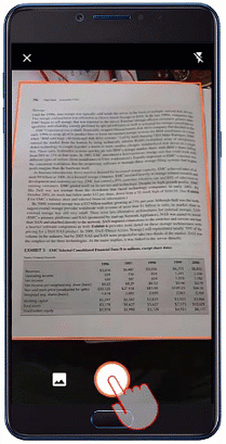 顯示 Android 手機正在拍攝相片並從影像中擷取 Excel 資料的影像。