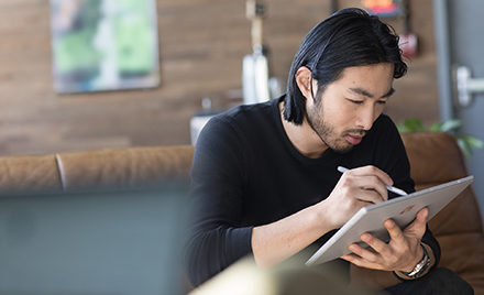 Image of a worker working on a tablet.