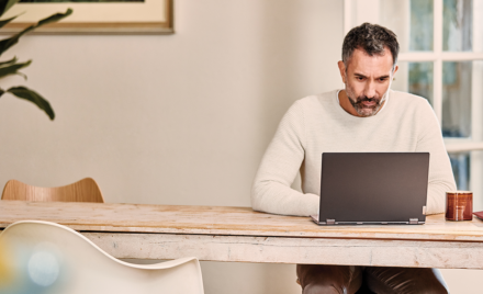 Image of a remote worker at his laptop.